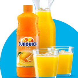 Sunquick concentrate with pitcher & glasses on blue background